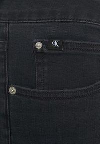 Calvin Klein Jeans Plus - HIGH RISE SKINNY ANKLE - Jeans Skinny Fit - denim black - 6
