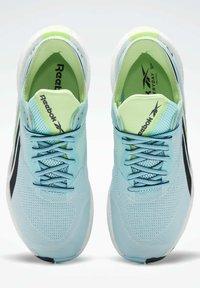Reebok - FLOATRIDE ENERGY SYMMETROS - Stabilty running shoes - blue - 8