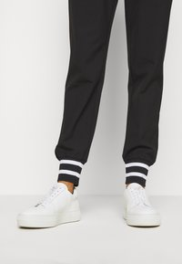 Kaffe - KAJOA PANTS - Trousers - black deep