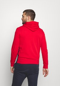 Champion - HOODED FULL ZIP SUIT - Tracksuit - red/dark blue - 2
