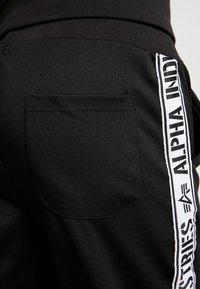 Alpha Industries - TRACK TAPE PANT - Tracksuit bottoms - schwarz - 4