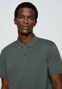 BOSS - KURZARM - Polo shirt - dark green - 3