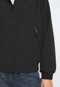 Carhartt WIP - KEYSTONE REVERSIBLE JACKET - Winter jacket - black - 5