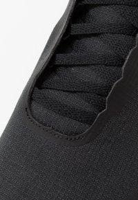 Reebok - TRAIL CRUISER - Trail running shoes - black - 5