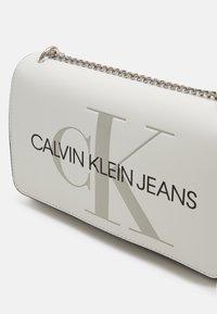 Calvin Klein Jeans - CONVERTIBLE FLAP - Across body bag - white - 3