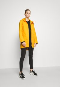Didriksons - FOLKA - Waterproof jacket - saffron yellow - 1