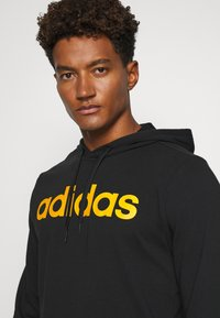 adidas Performance - ESSENTIALS SPORTS TRACKSUIT - Survêtement - black - 5