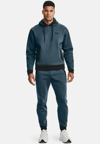 Under Armour - Tracksuit bottoms - blue - 1