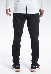 Reebok - SPEEDWICK TRACKSTER PANTS - Tracksuit bottoms - black - 2