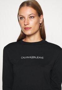 Calvin Klein Jeans - SHRUNKEN INST  - Long sleeved top - black - 4
