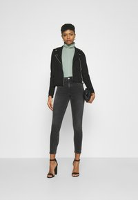 Vero Moda - VMBOOSTBIKER SHORT JACKET - Faux leather jacket - black - 1