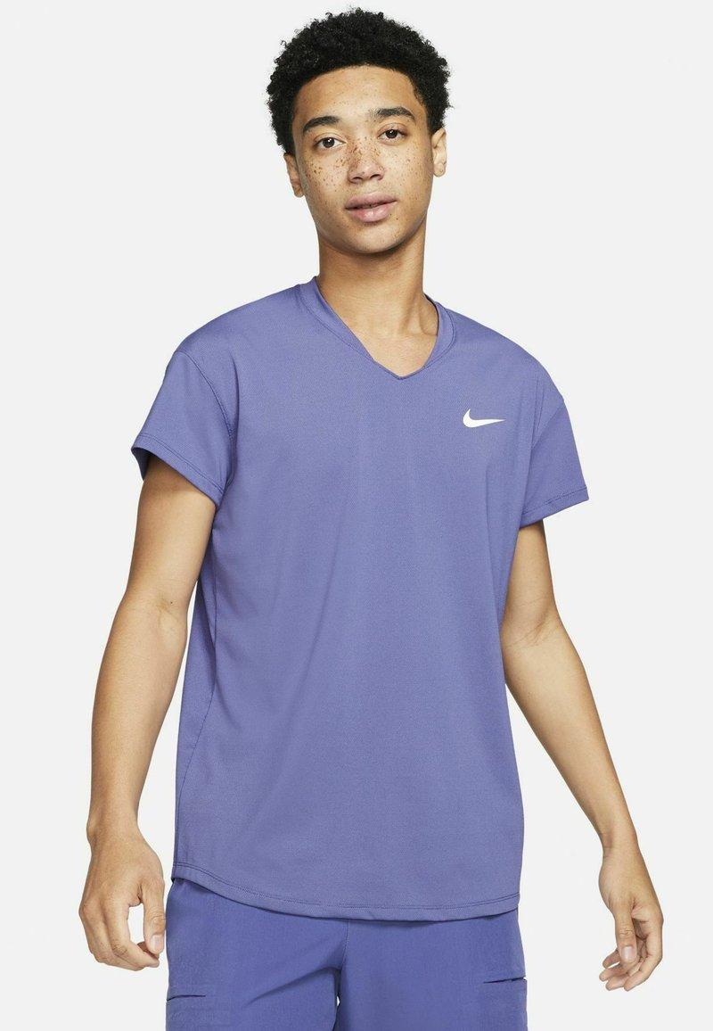 Nike Performance - T-shirt basic - dark purple