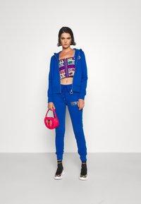 Versace Jeans Couture - PANTS - Tracksuit bottoms - blue - 1