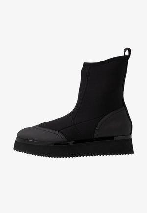 ALLE - Platform ankle boots - black