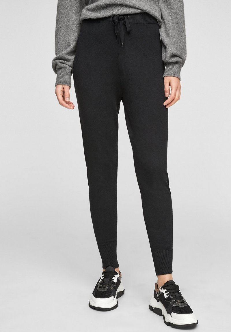 s.Oliver - Tracksuit bottoms - black