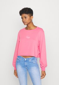Tommy Jeans - WASHED LOGO CREW - Sweatshirt - glamour pink - 1