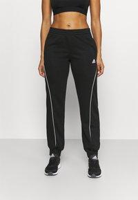 adidas Performance - Spodnie treningowe - black/white - 0