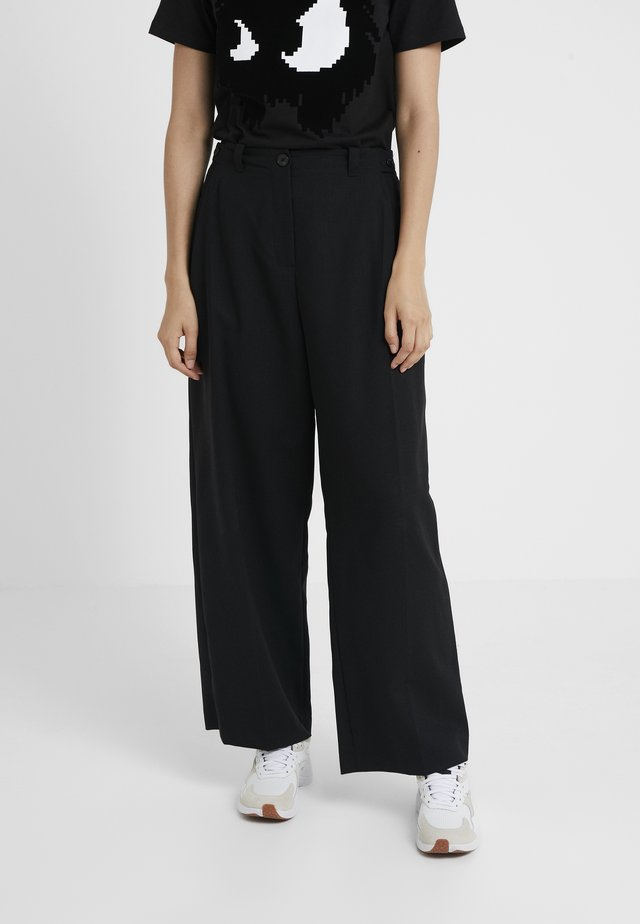LOOSE PANTS - Spodnie materiałowe - black
