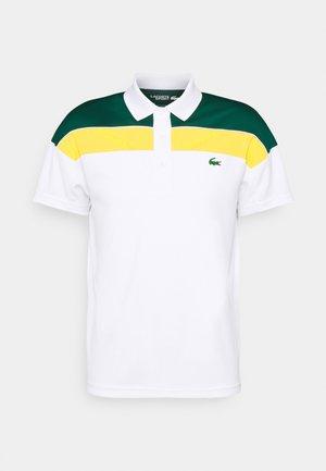 TENNIS TOUR - Polo shirt - white/swing daphne yellow/black