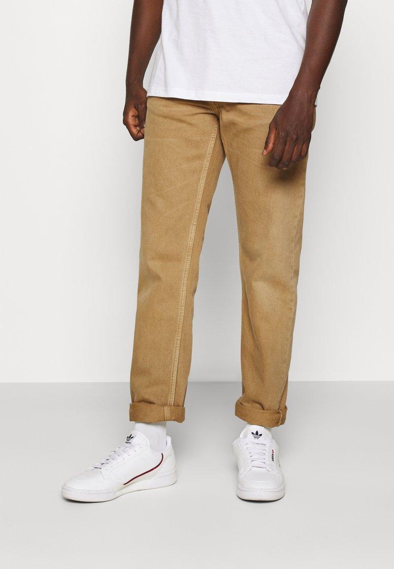 Nudie Jeans - STEADY EDDIE II - Relaxed fit jeans - desert worn