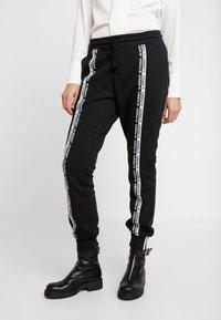 adidas Originals - R.Y.V. CUFFED SPORT PANTS - Verryttelyhousut - black - 0