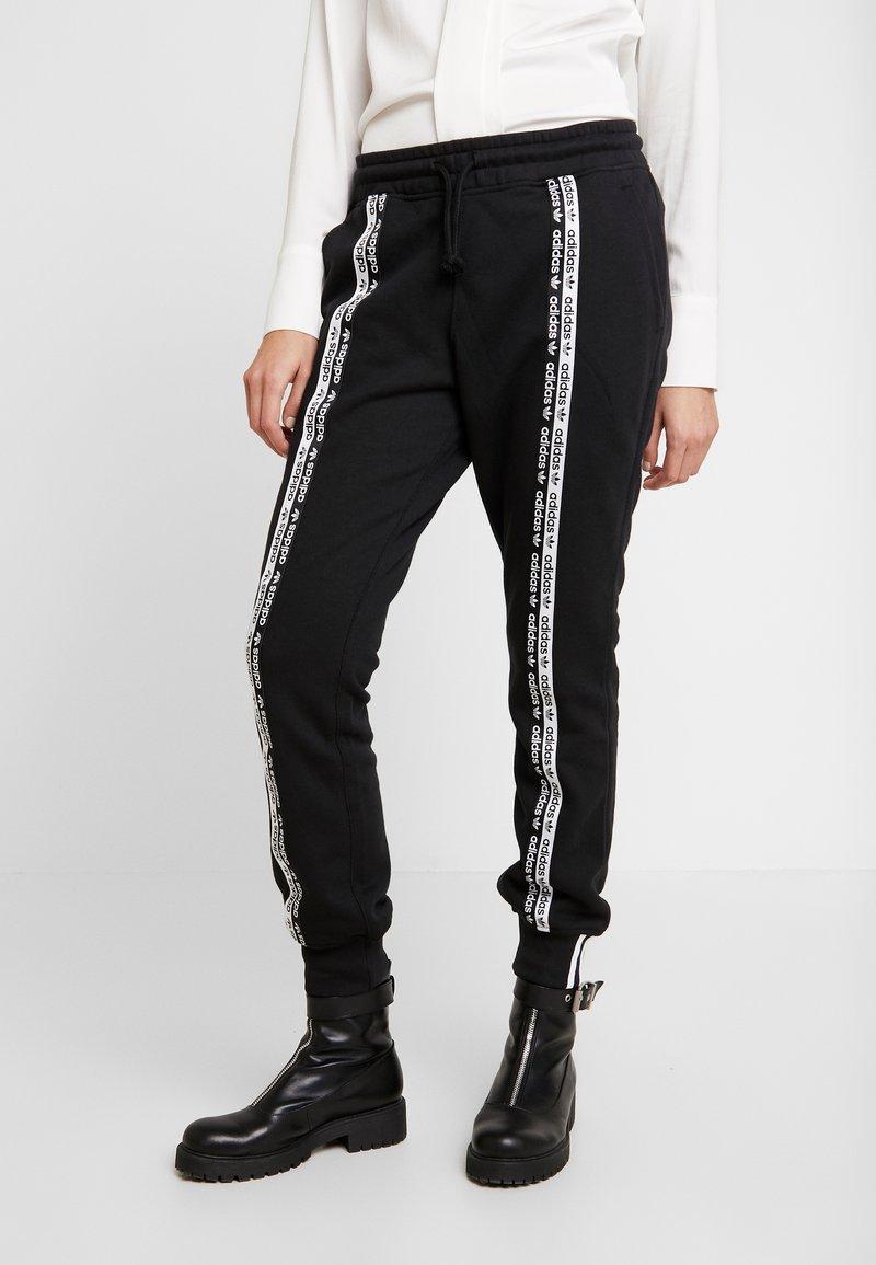 adidas Originals - R.Y.V. CUFFED SPORT PANTS - Verryttelyhousut - black