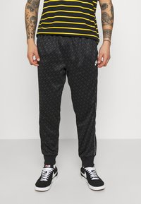 Nike Sportswear - REPEAT - Tracksuit bottoms - black/white - 0