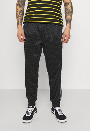 REPEAT - Tracksuit bottoms - black/white