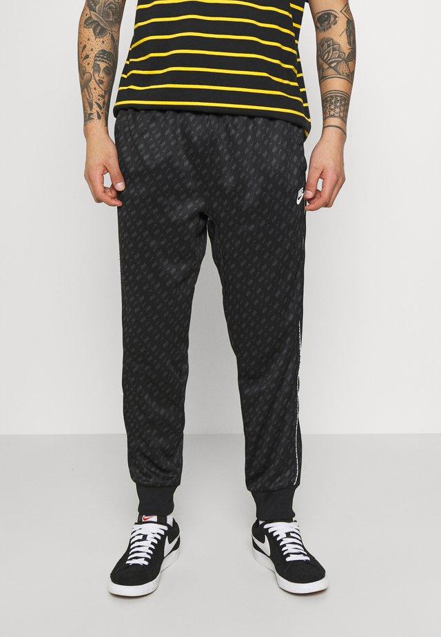 REPEAT - Spodnie treningowe - black/white
