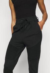 ONLY Petite - ONLPOPTRASH EASY  BIKER PANT - Tracksuit bottoms - black - 4