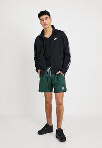 Nike Sportswear - TRIBUTE - Chaqueta de entrenamiento - black - 1