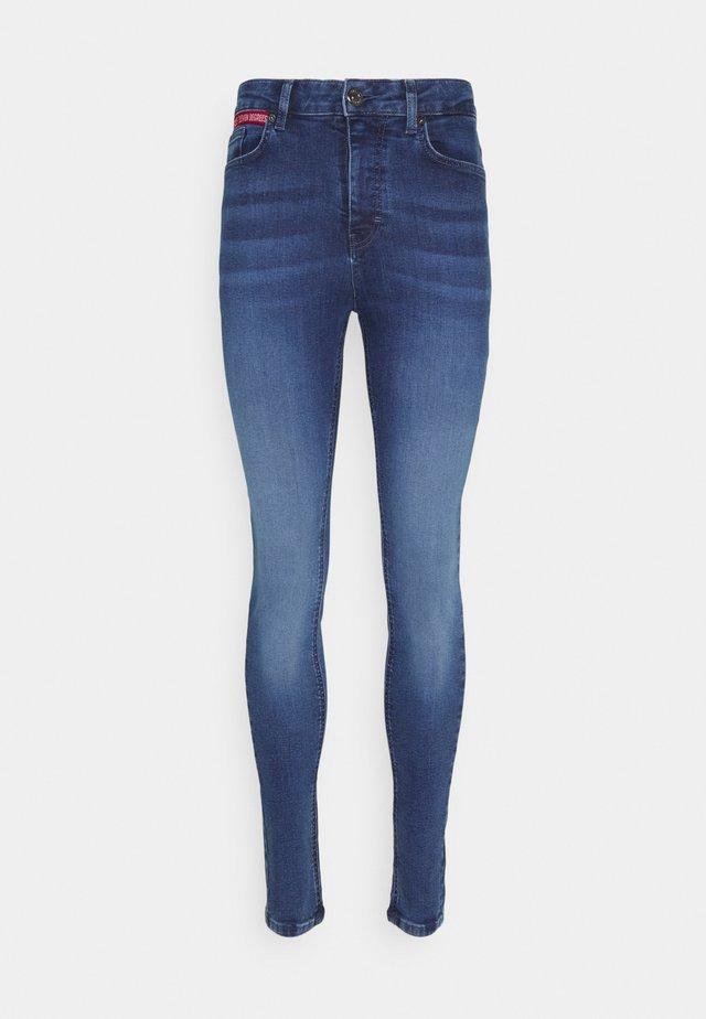 Skinny džíny - mid blue wash