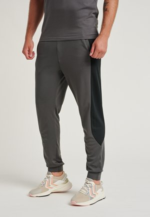 LOOSE FIT - Tracksuit bottoms - magnet