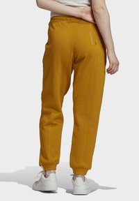 adidas Originals - Tracksuit bottoms - legacy gold - 1
