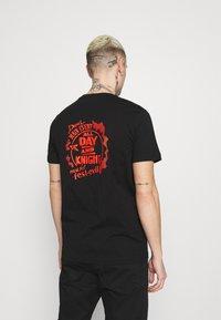 Diesel - T-DIEGOS-K15 - T-shirt con stampa - black - 0