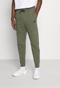 Nike Sportswear - Tracksuit bottoms - twilight marsh - 0