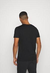 YOURTURN - UNISEX SET - Shorts - black - 4