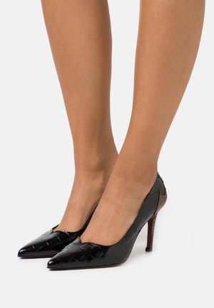 Zapatos altos - chino
