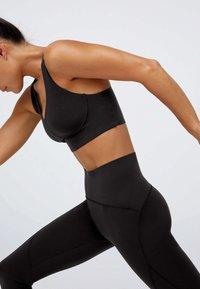 OYSHO - Medium support sports bra - black - 4