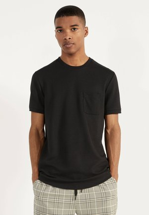 T-SHIRT MIT TASCHE 02389988 - Print T-shirt - black