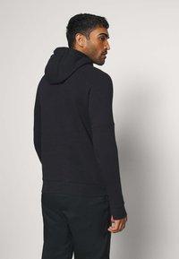 Nike Performance - POLEN HOOD - Club wear - black/white - 2
