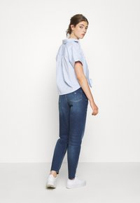Tommy Jeans - STRIPE KNOT BLOUSE - Button-down blouse - white/moderate blue - 2