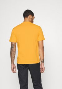 Caterpillar - SMALL LOGO TSHIRT - T-shirt basic - yellow - 2