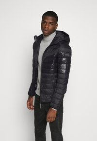 Calvin Klein - HOODED JACKET - Light jacket - black - 0