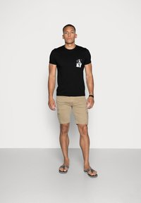 Calvin Klein Jeans - MIRRORED MONOGRAM SLIM TEE - T-shirts print - black/white - 1