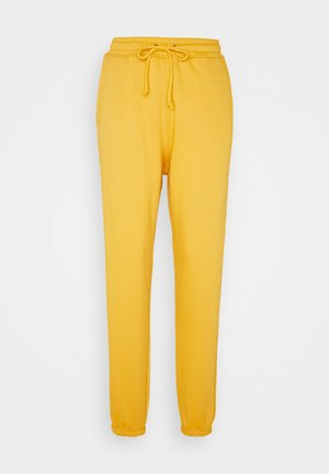 JOGGER - Tracksuit bottoms - yellow