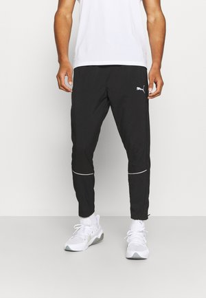RUN TAPERED PANT - Tracksuit bottoms - black