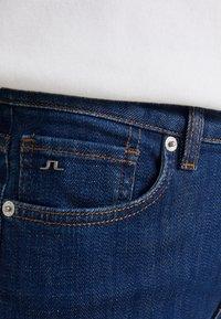 J.LINDEBERG - RODE RINSE - Slim fit jeans - mid blue - 6