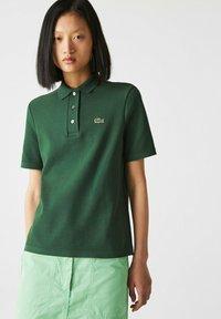 Lacoste - Polo shirt - grün - 0