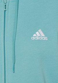 adidas Performance - Bluza rozpinana - mint ton/white - 6